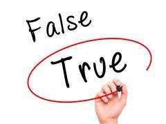 Man Hand writing an choosing True instead of False with black marker on visua Stock Photos