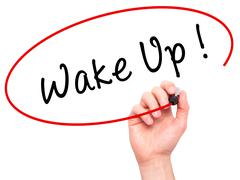 Man Hand writing Wake Up with black marker on visual screen - stock photo