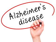 Man Hand writing Alzheimer's disease with black marker on visual screen Stock Photos