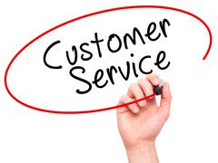 Stock Photo of Man Hand writing Customer service with black marker on visual screen