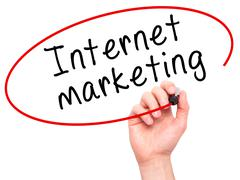 Man Hand writing Internet marketing with black marker on visual screen Kuvituskuvat