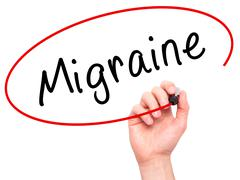 Man Hand writing Migraine with black marker on visual screen Stock Photos