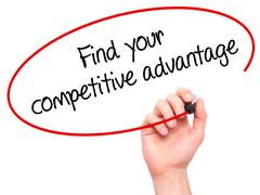 Man Hand writing Find your competitive advantage with marker on transparent w - stock photo