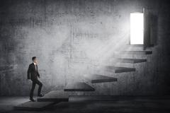 Asian business person going up to the door using stair Stock Photos