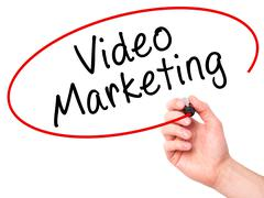 Man Hand writing Video Marketing black marker on visual screen Kuvituskuvat