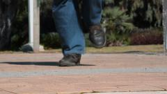 Man legs in brown working shoes running Stock Footage