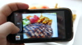 Closeup taking a photo picture of food via his smartphone camera 4k or 4k+ Resolution