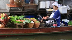 Thai woman prepares food in Taling Chan Floating Market, Bangkok, Thailand Stock Footage