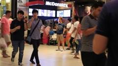 People walking near McDonald's restaurant. Siam Paragon Mall. Bangkok, Thailand Stock Footage