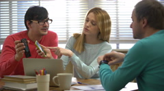 Young people using different electronic gadgets and talking in the office. 4k. Stock Footage