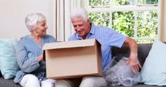 Senior couple opening box Stock Footage
