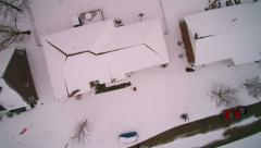 Aerial pull away shot of homes just after snow Stock Footage
