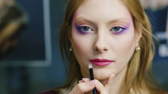 Stock Video Footage of Portrait of a photo model, she applied makeup