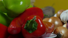 Red and green peppers, vegetables, dolly shot, shallow depth of field Stock Footage