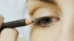Pencil colors upper eyelid female eye Stock Footage