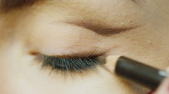 Pencil colors upper eyelid female eye - stock footage