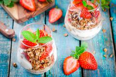 Homemade granola parfait with strawberry and mint. - stock photo