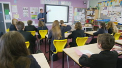 4K Young students listening to the teacher in school lesson - stock footage