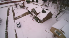 Overhead tracking shot of snow on house shortly after snow, Stock Footage