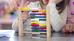 Mother is teaching her cute little daughter to count - stock footage
