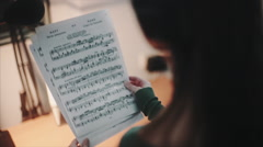 Girl teaches rehearsing lyrics Stock Footage