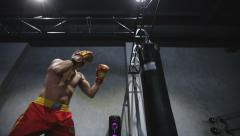 Sports: Man is practicing kick in a boxing gym. Slow motion - stock footage