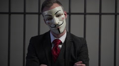 Stock Video Footage of Anonymous hacker in prison has head tilted with attitude