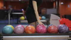 Stock Video Footage of Woman takes bowling ball. Close up
