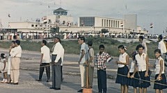 Aruba 1955: people waiting for Queen Juliana at the airport - stock footage