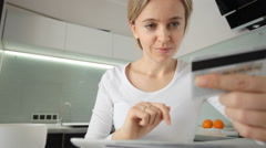 Adult woman with a credit card to order online shop Stock Footage