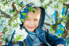 Close up of smiling beautiful child face. 7 years old kid playing hide and seek Stock Photos