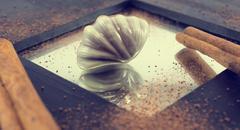 Chocolate praline on wooden background. - stock photo