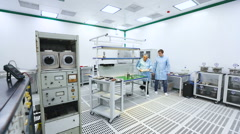 Two Engineers at the Tech Laboratory Testing Devices Instruments - stock footage