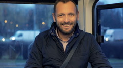 Portrait of happy man during tram ride Stock Footage