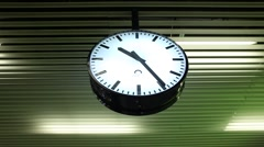 Contemporary round clock on a metal ceiling Stock Footage