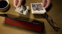 Browse old family photograph: parents, grandparents, family history, past Stock Footage