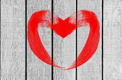 drawing heart love symbol on white wooden wall - stock photo