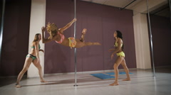 Girls having fun at a pole fitness class Stock Footage