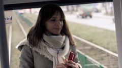 Young woman listening to the music during tram ride Stock Footage