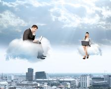 Business people working on clouds Stock Photos