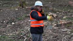 Angry Forest inspector with smartphone at clearcutting forest Stock Footage