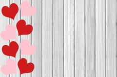 white wooden texture with red and pink hearts close-up - stock photo