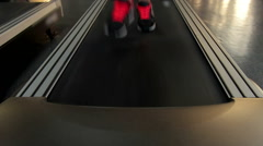 Feet of active person exercising on sports equipment, running on treadmill Stock Footage