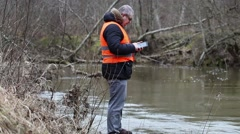 Environmental inspector with tablet PC near the river Stock Footage