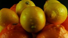 Citrus Rotating Against Black Background Stock Footage