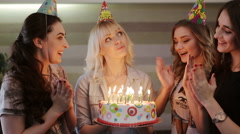 Birthday girl makes a wish and blows out the candles on the cake Stock Footage