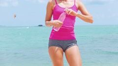 Fitness sport woman doing sporty exercise  on beach outside at sunset. Healthy Stock Footage