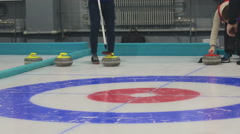 Girl curlers rolls a curling stone Stock Footage