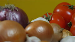 Dolly shot from onion to red tomatoes, extreme close up, vegetables Stock Footage