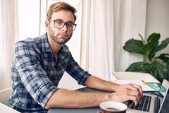 Self employed entrepreneur looking at camera - stock photo